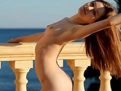 Gorgeous girl Zoe posing naked on the terrace