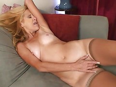 Old lady Skowshi in stockings plays with her old twat