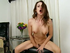 MILF Nora Noir shows her shaved pussy