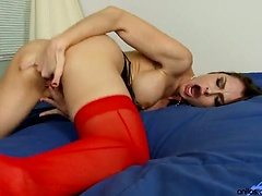 Nora Noir in red stockings plays with her pussy