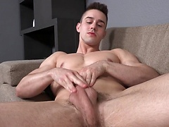 Liam strockes his muscled cock
