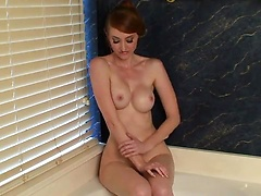 Sexy readhead Holly Jane takes bath