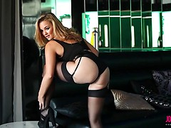 Jodie in black lingerie and stockings