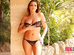 Jodie Gasson in her black lingerie outdoors.