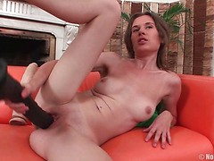 Cute, leggy brunette Nadya has two gigantic dildos and a desire to stretch her slippery cunt like it's never been stretched before. She sucks both toys to get them nice and wet and bangs her snatch with them, moaning as the walls of her cunt stretch aro