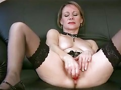 Sexy cougar in lingerie and heels reveals her wet pussy and shows us how she likes to use her toys to masturbate