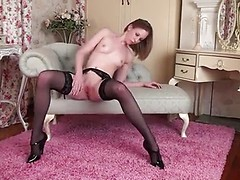 Slender UK mom is a bit nervous as she does her first naughty video but quickly succumbs to the pleasure as she slips off her lingerie and massages her bald snatch