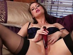 Seductive auburn haired mom Karina Currie loves to talk dirty when she fucks her juicy wet pussy with a home made dildo