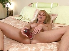 Sexy Shayla Laveaux gets interviewed while gently stroking her mature pussy with the rabbit toy