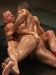 Two hot, hung studs wrestle for the right to a brutal victory fuck that will leave the loser\'s ass sore and in shame.