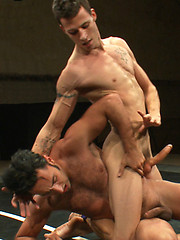 Two brutally hot studs tear each other to pieces on the mat then fuck their brains out.