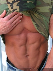 Peter Latz strips out of his fatigues