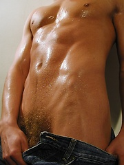 Michael Davids squeezes orange juice all over ripped body.