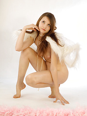 Teen angel poses nude
