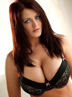 Sophie Dee digs her fingers deep into her sheer black panties