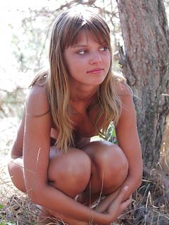 Petite teen poses