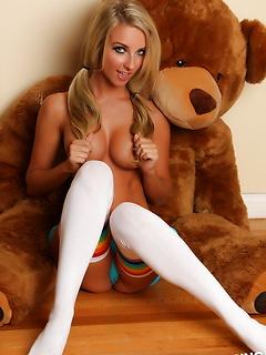 Busty blonde Alluring Vixen babe Aneta teases in a skimpy string bikini