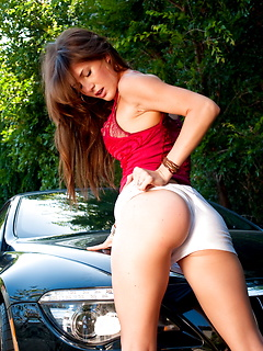 Devine One Jenni Lee pulls down her shorts to expose her tight pussy while bent over the front of her friends BMW