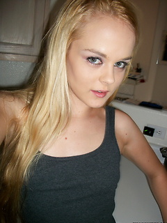 Petite blonde teen takes selfshot pictures of her perky tits and tight pussy for her boyfriend